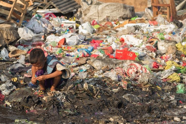 Child scavenges in Tondo, Manila. Photo credit: Adam Kohn